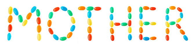 Mother lettering made of multicolored candies isolated on white Stock Photos