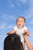 Mother lift baby up Royalty Free Stock Photo