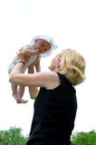 Mother Lifting Baby Royalty Free Stock Photo