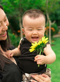 Mother lifting baby up Royalty Free Stock Photo