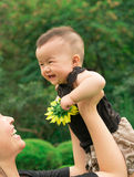 Mother lifting baby up Royalty Free Stock Image