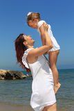 Mother lifting daughter Stock Photography