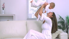 Mother lifting her child in the air stock video footage