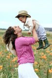 Mother Lifting Her Child Up Royalty Free Stock Photography