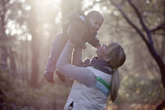 A mother lifting her son in the air Royalty Free Stock Image