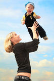 Mother lifts child on hands outdoor Royalty Free Stock Photography