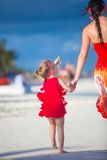 Mother and little adorable daughter walking at Royalty Free Stock Images
