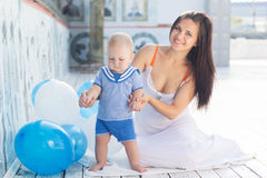 Mother and little baby boy with balloons outdoors Royalty Free Stock Photos
