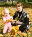 Mother with little baby outdoor Stock Image