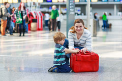 Mother and little boy at the airport, indoors Stock Photography