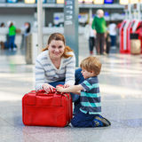 Mother and little boy at the airport, indoors Royalty Free Stock Image
