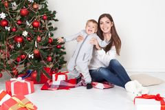 Mother and little boy at Christmas tree with gifts 1 Royalty Free Stock Photo
