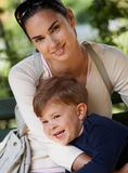 Mother and little boy cuddling in park Royalty Free Stock Photography