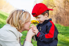 Mother and little boy with flower Stock Photos
