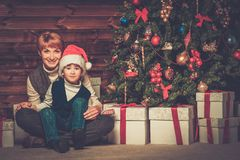 Mother and lIttle boy with gift box Stock Image