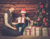 Mother and lIttle boy with gift box Stock Images
