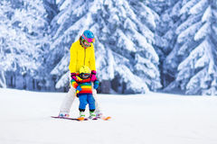 Mother and little boy learning to ski Stock Photo
