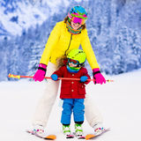 Mother and little boy learning to ski Stock Image