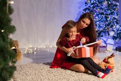 Mother and little boy open Gifts Christmas tree new year royalty free stock photography
