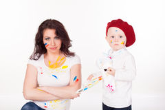 Mother and little boy paints when painted Royalty Free Stock Photography