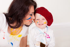 Mother and little boy paints when painted Royalty Free Stock Image