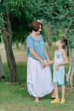 Mother with little boy in the park under a tree Royalty Free Stock Photo