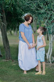 Mother with little boy in the park under a tree Stock Images