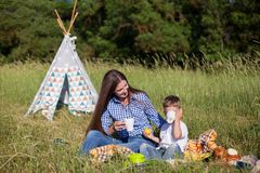 Mother and little boy on a picnic at the tents stock photos
