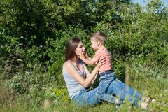 Mother and little boy play park family happiness. Mother and little boy play park happiness stock photography