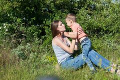 Mother and little boy play park family happiness. Mother and little boy play park happiness stock images