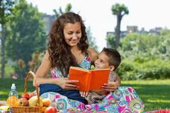 Mother and little boy reading. Book together Royalty Free Stock Photos