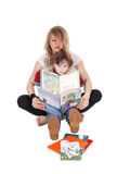 Mother and little boy reading. A mother has her little boy on her lap and read some books to him, isolated for white background stock images