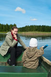 Mother and little child in boat Royalty Free Stock Photos