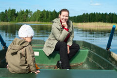Mother and little child in boat Royalty Free Stock Photography