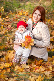 Mother and little daughter in autumn park Royalty Free Stock Photo