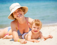Mother with little daughter on the beach Royalty Free Stock Image