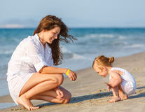 Mother with little daughter on the beach Stock Photos