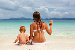 Mother with little daughter on the beach. This is photograph of Mother with little daughter on the beach Royalty Free Stock Images