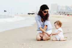 Mother and little daughter. On the beach Royalty Free Stock Photos