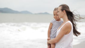 Mother with a little daughter on the beach with bad weather. stock video footage