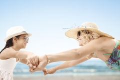 Mother and little daughter on beach. Mother and little beautiful daughter on beach Royalty Free Stock Photos