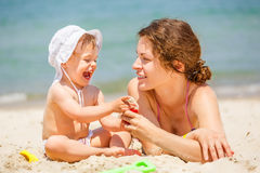 Mother with little daughter on the beach Royalty Free Stock Images
