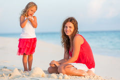 Mother with little daughter on the beach. Mother with little daughter playing on the beach Royalty Free Stock Image