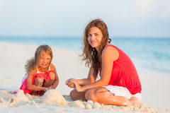 Mother with little daughter on the beach. Mother with little daughter playing on the beach Royalty Free Stock Images