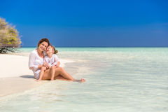 Mother and little daughter on the beach Royalty Free Stock Image