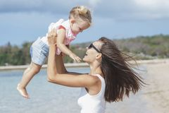 Mother and little daughter on the beach. Portrait of mother and little daughter on the beach Royalty Free Stock Image