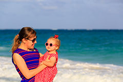 Mother and little daughter on beach vacation. Mother and little daughter on tropical beach vacation Stock Image