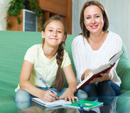 Mother with little daughter  doing homework Stock Photo
