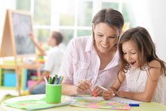Mother with little daughter drawing Stock Photography