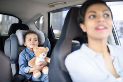 Mother and little daughter driving in car together. Portrait of mother and little daughter driving in car together Royalty Free Stock Images